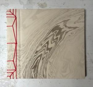 legatura orientale in cartoncino e carta suminagashi